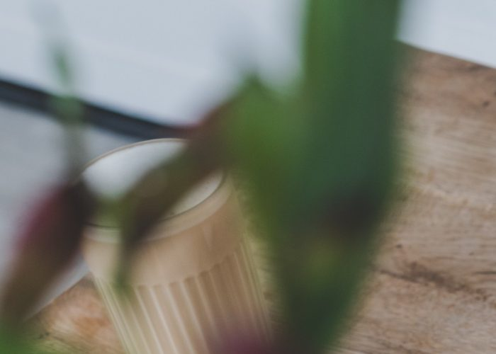 Coffee on wooden table with plants
